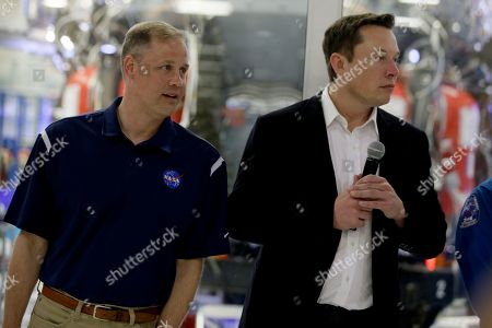 NASA Administrator Jim Bridenstine, left, with SpaceX chief engineer Elon Musk, right, listen to a question from the media about the progress to fly astronauts to and from the International Space Station, from American soil, as part of the agency's commercial crew program at SpaceX headquarters, in Hawthorne, Calif