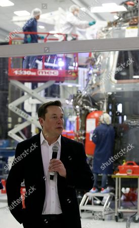 Stock Image of SpaceX chief engineer Elon Musk talks to the media in front of the Crew Dragon spacecraft about the progress to fly astronauts to and from the International Space Station, from American soil, as part of the agency's commercial crew program at SpaceX headquarters, in Hawthorne, Calif