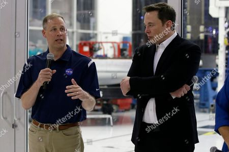 NASA Administrator Jim Bridenstine, left, talks to the media with SpaceX chief engineer Elon Musk, right, about the progress to fly astronauts to and from the International Space Station, from American soil, as part of the agency's commercial crew program at SpaceX headquarters, in Hawthorne, Calif