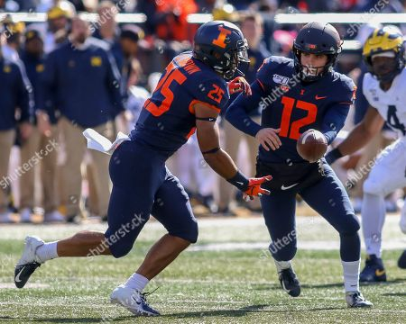 Saturday th -Illinois Fighting Illini quarterback Matt Robinson (12) hands off to Illinois Fighting Illini running back Dre Brown (25) during NCAA football game action between the University of Illinois Fighting Illini vs the Michigan University Wolverines at Memorial Stadium in Champaign, ILL