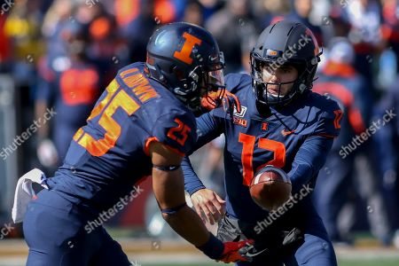 Saturday th - Illinois Fighting Illini quarterback Matt Robinson (12) hands off to Illinois Fighting Illini running back Dre Brown (25) during NCAA football game action between the University of Illinois Fighting Illini vs the Michigan University Wolverines at Memorial Stadium in Champaign, ILL