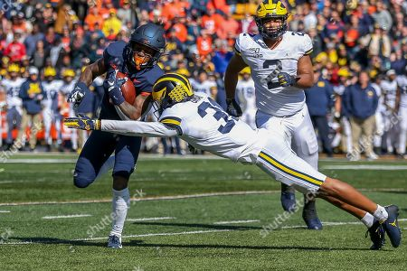 Saturday th - Illinois Fighting Illini wide receiver Dominic Stampley (6) avoids the diving tacklle attempt by Michigan Wolverines defensive back Vincent Gray (31) during NCAA football game action between the University of Illinois Fighting Illini vs the Michigan University Wolverines at Memorial Stadium in Champaign, ILL