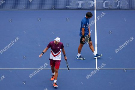Marcelo Melo, Lukasz Kubot. Marcelo Melo of Brazil, right, and his partner Lukasz Kubot of Poland react during their men's doubles final against Mate Pavic of Croatia and Bruno Soares of Brazil at the Shanghai Masters tennis tournament at Qizhong Forest Sports City Tennis Center in Shanghai, China