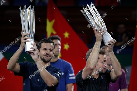 Mate Pavic, Bruno Soares. Mate Pavic of Croatia, left, and his partner Bruno Soares of Brazil lift their winner trophies after defeating Lukasz Kubot of Poland and Marcelo Melo of Brazil in the men's doubles final at the Shanghai Masters tennis tournament at Qizhong Forest Sports City Tennis Center in Shanghai, China