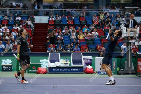 Mate Pavic, Bruno Soares. Mate Pavic of Croatia, right, celebrates with his partner Bruno Soares of Brazil after defeating Lukasz Kubot of Poland and Marcelo Melo of Brazil in the men's doubles final at the Shanghai Masters tennis tournament at Qizhong Forest Sports City Tennis Center in Shanghai, China