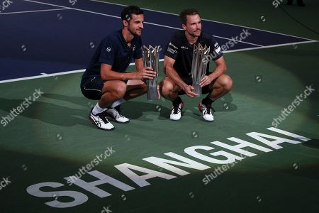 Mate Pavic, Bruno Soares. Mate Pavic, left, of Croatia and his partner Bruno Soares of Brazil pose with their winner trophies after defeating Lukasz Kubot of Poland and Marcelo Melo of Brazil in the men's doubles final at the Shanghai Masters tennis tournament at Qizhong Forest Sports City Tennis Center in Shanghai, China