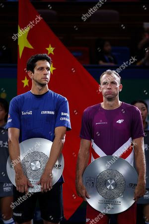 Lukasz Kubot, Marcelo Melo. Lukasz Kubot of Poland, right, and his partner Marcelo Melo of Brazil hold their second place trophies after they lost to Mate Pavic of Croatia and Bruno Soares of Brazil in the men's doubles final at the Shanghai Masters tennis tournament at Qizhong Forest Sports City Tennis Center in Shanghai, China