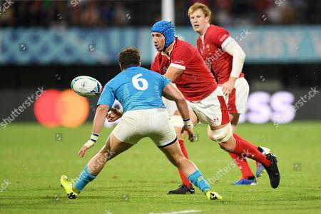 Justin Tipuric of Wales passes the ball past Juan Manuel Gaminara of Uruguay.