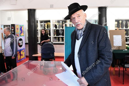 Janusz Korwin-Mikke from the Confederation Coalition at a polling station during the parliamentary elections in Warsaw, Poland, 13 October 2019. An average of eleven candidates are running for each Sejm (lower house) seat in the national elections. In total, 5,114 people are running for 460 seats. Two hundred and seventy-eight people are running for the Senate (upper house), three candidatures for each seat. Five electoral committees were registered in all 41 constituencies, namely, the ruling Law and Justice (PiS) party, Poland's main opposition bloc the Civic Coalition (KO), the Polish People's Party (PSL) with Kukiz'15 party, the Confederation Freedom and Independence and the Left (Lewica) bloc comprising liberal and left-wing parties the Democratic Left Alliance (SLD), Spring and Together.