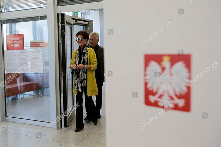 Former Polish President Aleksander Kwasniewski with his wife Jolanta at a polling station during the parliamentary elections in Warsaw, Poland, 13 October 2019. An average of eleven candidates are running for each Sejm (lower house) seat in the national elections. In total, 5,114 people are running for 460 seats. Two hundred and seventy-eight people are running for the Senate (upper house), three candidatures for each seat. Five electoral committees were registered in all 41 constituencies, namely, the ruling Law and Justice (PiS) party, Poland's main opposition bloc the Civic Coalition (KO), the Polish People's Party (PSL) with Kukiz'15 party, the Confederation Freedom and Independence and the Left (Lewica) bloc comprising liberal and left-wing parties the Democratic Left Alliance (SLD), Spring and Together.