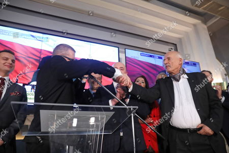 Janusz Korwin-Mikke (R) and Jakub Kulesza (L) from the Confederation Coalition react during parliamentary elections night in Warsaw, Poland, 13 October 2019. An average of eleven candidates are running for each Sejm (lower house) seat in the national elections. In total, 5,114 people are running for 460 seats. Two hundred and seventy-eight people are running for the Senate (upper house), three candidatures for each seat. Five electoral committees were registered in all 41 constituencies, namely, the ruling Law and Justice (PiS) party, Poland's main opposition bloc the Civic Coalition (KO), the Polish People's Party (PSL) with Kukiz'15 party, the Confederation Freedom and Independence and the Left (Lewica) bloc comprising liberal and left-wing parties the Democratic Left Alliance (SLD), Spring and Together.
