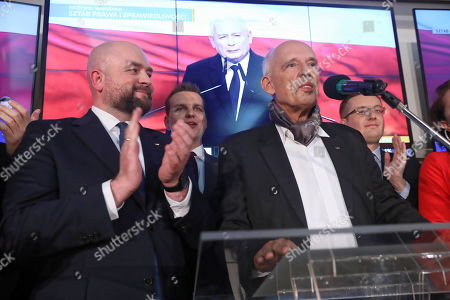 Janusz Korwin-Mikke (R) and Bartlomiej Pejo (L) from the Confederation Coalition react during parliamentary elections night in Warsaw, Poland, 13 October 2019. An average of eleven candidates are running for each Sejm (lower house) seat in the national elections. In total, 5,114 people are running for 460 seats. Two hundred and seventy-eight people are running for the Senate (upper house), three candidatures for each seat. Five electoral committees were registered in all 41 constituencies, namely, the ruling Law and Justice (PiS) party, Poland's main opposition bloc the Civic Coalition (KO), the Polish People's Party (PSL) with Kukiz'15 party, the Confederation Freedom and Independence and the Left (Lewica) bloc comprising liberal and left-wing parties the Democratic Left Alliance (SLD), Spring and Together.