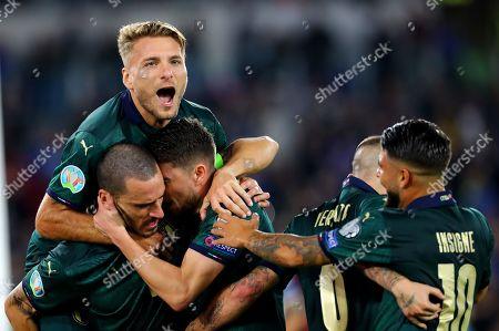 Jorginho of Italy celebrates with Ciro Immobile and Leonardo Bonucci after scoring