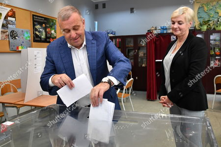 Head of the main opposition party Civic Platform (PO) Grzegorz Schetyna and his wife Kalina at a polling station during the parliamentary elections in Wroclaw, Poland, 13 October 2019. An average of eleven candidates are running for each Sejm (lower house) seat in the national elections. In total, 5,114 people are running for 460 seats. Two hundred and seventy-eight people are running for the Senate (upper house), three candidatures for each seat. Five electoral committees were registered in all 41 constituencies, namely, the ruling Law and Justice (PiS) party, Poland's main opposition bloc the Civic Coalition (KO), the Polish People's Party (PSL), the Confederation Freedom and Independence and the Left (Lewica) bloc comprising liberal and left-wing parties the Democratic Left Alliance (SLD), Spring and Together.