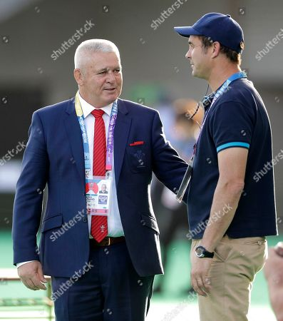 Wales coach Warren Gatland, left, and Uruguay coach Esteban Mensese chat ahead of the Rugby World Cup Pool D game at Kumamoto Stadium between Wales and Uruguay in Kumamoto, Japan