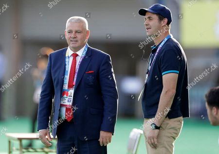 Stock Picture of Wales coach Warren Gatland, left, and Uruguay coach Esteban Mensese chat ahead of the Rugby World Cup Pool D game at Kumamoto Stadium between Wales and Uruguay in Kumamoto, Japan