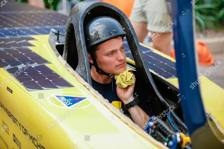 University of Michigan Solar Car Team driver Zac Goldsmith of the USA with their solar-powered car Electrum at the start line of the 2019 World Solar Challenge at State Square in Darwin, Northern Territory, Australia, 13 October 2019. Leading cars in the World Solar Challenge have passed scrutineering ahead of their 3,000km sun-powered journey from Darwin to Adelaide, South Australia.