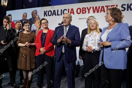 "Grzegorz Schetyna, center, one of the leaders of opposition ""Civic Coalition"" addresses supporters at the coalition headquarters in Warsaw, Poland, . An exit poll indicates that Poland's conservative ruling party Law and Justice has won the most votes in a general election"