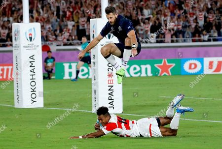 Scotland's Tommy Seymour leaps over Japan's Kotaro Matsushima as he scores a try during the Rugby World Cup Pool A game at International Stadium between Japan and Scotland in Yokohama, Japan