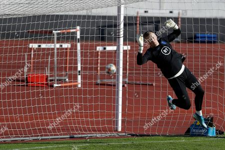 England goalkeeper Jordan Pickford is airborne during a training session in Prague, Czech Republic, . England plays Bulgaria in the Euro 2020 group A qualifying soccer match in Sofia on Monday