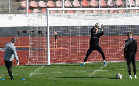 England goalkeeper Jordan Pickford catches a ball during a training session in Prague, Czech Republic, . England plays Bulgaria in the Euro 2020 group A qualifying soccer match in Sofia on Monday