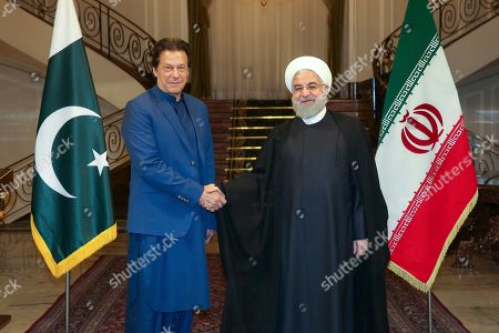 Hassan Rouhani, Imran Khan. In this photo released by the official website of the office of the Iranian Presidency, President Hassan Rouhani, right, and Pakistani Prime Minister Imran Khan shake hands for media prior to their meeting at the Saadabad Palace in Tehran, Iran