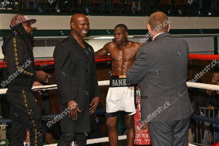 Nathanael Wilson (blue gloves) with Chris Eubank Snr during a Boxing Show at York Hall on 12th October 2019