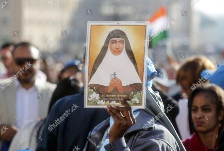 A faithful with a picture of Mariam Thresia Chiramel Mankidiyan during the canonization Mass of five new Saints in St. Peters Square at the Vatican, 13 October 2019. Five new Saints are canonized at the Vatican on 13 October 2019, namely Brazilian Sister Dulce Lopes Pontes, Swiss Franciscan tertiary Marguerite Bays, Sister Giuseppina Vannini, India's Mother Mariam Thresia Mankidiyan, and British Cardinal John W. Henry Newman.