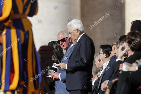Britain's Charles, Prince Charles (L) and Sergio Mattarella (R), Italian President, during the canonization Mass of five new Saints in St. Peters Square at the Vatican, 13 October 2019. Five new Saints are canonized at the Vatican on 13 October 2019, namely Brazilian Sister Dulce Lopes Pontes, Swiss Franciscan tertiary Marguerite Bays, Sister Giuseppina Vannini, India's Mother Mariam Thresia Mankidiyan, and British Cardinal John W. Henry Newman.
