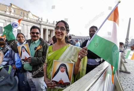 Faithfuls with pictures of Mariam Thresia Chiramel Mankidiyan during the canonization Mass of five new Saints in St. Peters Square at the Vatican, 13 October 2019. Five new Saints are canonized at the Vatican on 13 October 2019, namely Brazilian Sister Dulce Lopes Pontes, Swiss Franciscan tertiary Marguerite Bays, Sister Giuseppina Vannini, India's Mother Mariam Thresia Mankidiyan, and British Cardinal John W. Henry Newman.