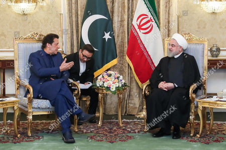 A handout photo made available by the presidential office shows Iranian President Hassan Rouhani (R) meeting with Pakistani Prime Minister Imran Khan (L) at presidential palace in Tehran, Iran, 13 October 2019. Media reported that Imran Khan is in Tehran to meet with Iranian officials.