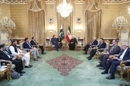 A handout photo made available by the presidential office shows Iranian President Hassan Rouhani (C-R) meeting with Pakistani Prime Minister Imran Khan (C-L) at presidential palace in Tehran, Iran, 13 October 2019. Media reported that Imran Khan is in Tehran to meet with Iranian officials.