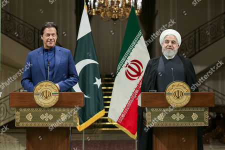 A handout photo made available by the presidential office shows Iranian President Hassan Rouhani (R) and Pakistani Prime Minister Imran Khan (L) during a joint press conference at presidential palace in Tehran, Iran, 13 October 2019. Media reported that Imran Khan is in Tehran to meet with Iranian officials.