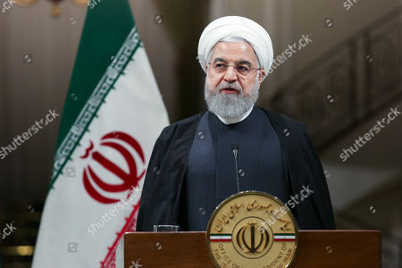 A handout photo made available by the presidential office shows Iranian President Hassan Rouhani during a joint press conference at presidential palace in Tehran, Iran, 13 October 2019. Media reported that Imran Khan is in Tehran to meet with Iranian officials.