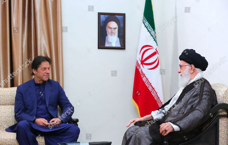 A handout photo made available by the supreme leader office shows Iranian Supreme leader Ayatollah Ali Khamenei meeting with Pakistani Prime Minister Imran Khan (L) in Tehran, Iran, 13 October 2019. Media reported that Imran Khan is in Tehran to meet with Iranian officials.