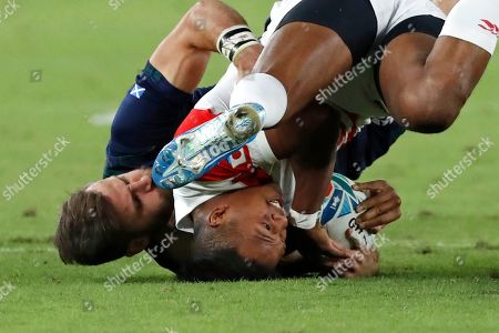 Scotland's Tommy Seymour, left, tackles Japan's Kotaro Matsushima during the Rugby World Cup Pool A game at International Stadium between Japan and Scotland in Yokohama, Japan