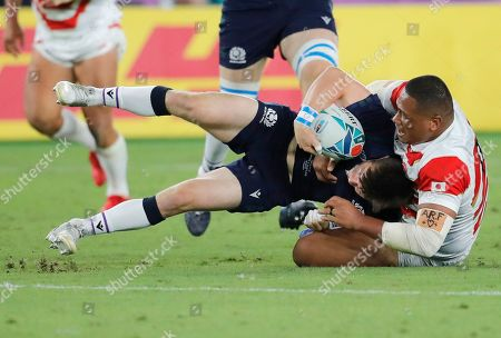 Japan's Asaeli Ai Valu tackles Scotland's Tommy Seymour during the Rugby World Cup Pool A game at International Stadium between Japan and Scotland in Yokohama, Japan