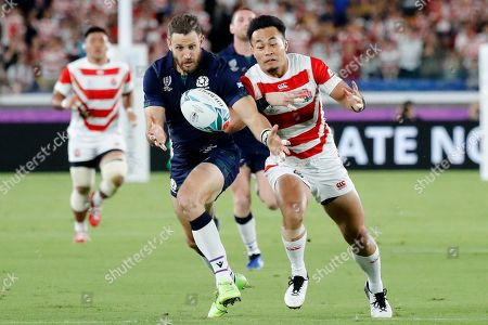 Scotland's Tommy Seymour, left, and Japan's Kenki Fukuoka vie for the ball during the Rugby World Cup Pool A game at International Stadium between Japan and Scotland in Yokohama, Japan