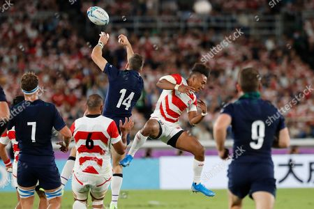 Scotland's Tommy Seymour (14) and Japan's Kotaro Matsushima vie for the ball during the Rugby World Cup Pool A game at International Stadium between Japan and Scotland in Yokohama, Japan
