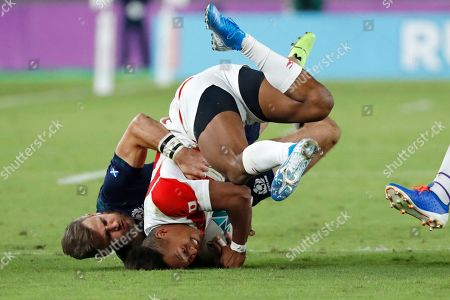 Japan's Kotaro Matsushima is tackled by Scotland's Tommy Seymour during the Rugby World Cup Pool A game at International Stadium between Japan and Scotland in Yokohama, Japan