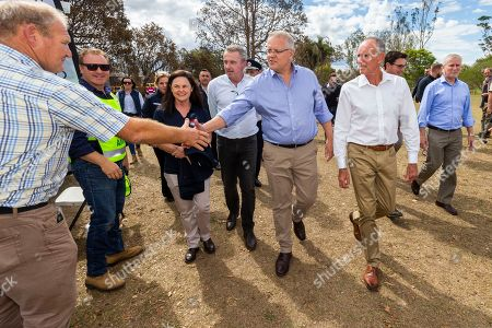 Australian Prime Minister Scott Morrison (C) greets members of the local community as he visits fire affected Rappville, New South Wales, Australia, 13 October 2019. Morrison visited on the day bushfire-ravaged communities in northern New South Wales. Firefighters are still working to contain the fires as temperatures and winds are expected to increase during the week.