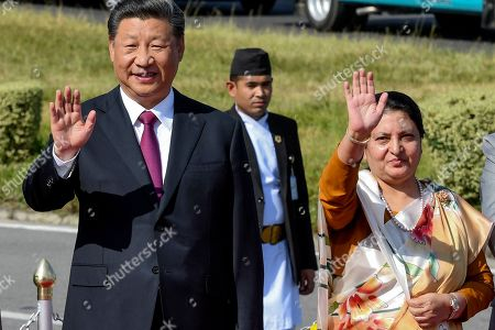 Nepal's President Bidhya Devi Bhandari (R) and China's President Xi Jinping (L) wave as the latter bids farewell at the conclusion of his two-day visit to Nepal, in Kathmandu, Nepal, 13 October 2019. Xi was on a two-day visit to Nepal.