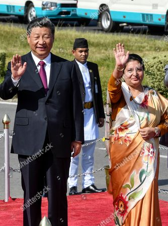 Nepal's President Bidhya Devi Bhandari (R) and China's President Xi Jinping (L) wave as the latter bids farewell wrapping up his two-day visit to Nepal, in Kathmandu, Nepal, 13 October 2019. Xi was on a two-day visit to Nepal.