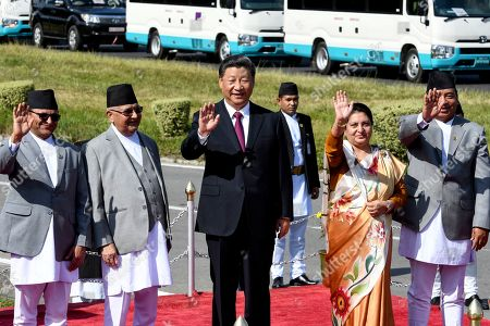 Chairman of National Assembly of Nepal Ganesh Prasad Timilsina (L), Nepal's Prime Minister KP Sharma Oli (2-L), China's President Xi Jinping (C), Nepal's President Bidhya Devi Bhandari (2-R) and Vice President Nanda Kishor Pun (R), wave as Xi Jinping is about to leave, wrapping up his two-day visit to Nepal, in Kathmandu, Nepal, 13 October 2019. Xi was on a two-day visit to Nepal.