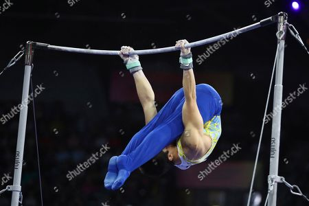 Gold medalist Arthur Mariano of Brazil performs in the horizontal bar exercise in the men's apparatus finals at the Gymnastics World Championships in Stuttgart, Germany