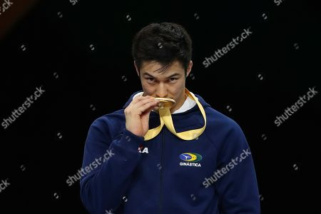 Arthur Mariano of Brazil kisses his gold medal during the award ceremony for the horizontal bar exercise in the men's apparatus finals at the Gymnastics World Championships in Stuttgart, Germany