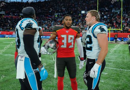 Stock Image of Tampa Bay Buccaneers Defensive Back Andrew Adams (39) in discussion with the Carolina Panthers following the 37-26 defeat