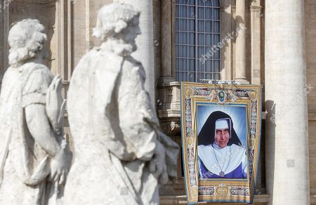 The tapestry of the new Saint Dulce Lopes Pontes on St. Peters Basilica during the canonization Mass in St. Peters Square at the Vatican, 13 October 2019. Five new Saints are canonized at the Vatican on 13 October 2019, namely Brazilian Sister Dulce Lopes Pontes, Swiss Franciscan tertiary Marguerite Bays, Sister Giuseppina Vannini, India's Mother Mariam Thresia Mankidiyan, and British Cardinal John W. Henry Newman.