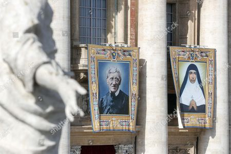 Stock Picture of The tapestries of the new Saints Cardinal John W. Henry Newman (L) and Mariam Thresia Chiramel Mankidiyan (R) during the canonization Mass of five new Saints in St. Peters Square at the Vatican, 13 October 2019. Five new Saints are canonized at the Vatican on 13 October 2019, namely Brazilian Sister Dulce Lopes Pontes, Swiss Franciscan tertiary Marguerite Bays, Sister Giuseppina Vannini, India's Mother Mariam Thresia Mankidiyan, and British Cardinal John W. Henry Newman.