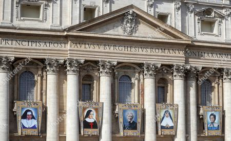The tapestries of the five new Saints on St. Peters Basilica during the canonization Mass in St. Peters Square at the Vatican, 13 October 2019. Five new Saints are canonized at the Vatican on 13 October 2019, namely Brazilian Sister Dulce Lopes Pontes, Swiss Franciscan tertiary Marguerite Bays, Sister Giuseppina Vannini, India's Mother Mariam Thresia Mankidiyan, and British Cardinal John W. Henry Newman.